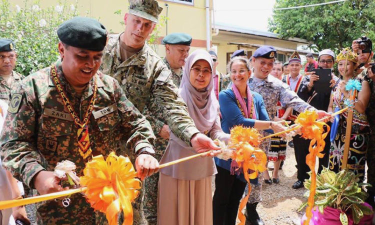 U.S., Malaysian, and Japanese military engineers joined together to construct new buildings for a primary school in Batu Kawa, Sarawak. (U.S. Embassy photo)