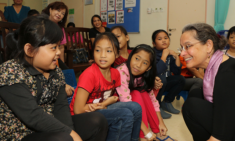 Ambassador Lakhdhir with young patients during her visit at the Women's and Children's Hospital in Kota Kinabalu. (U.S. Embassy photo)
