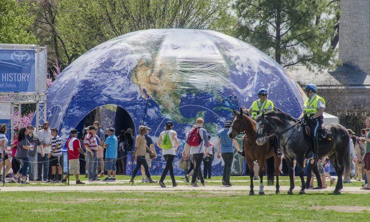 People visiting earth dome