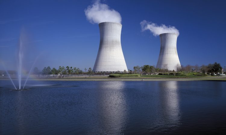 Two cooling towers across the water