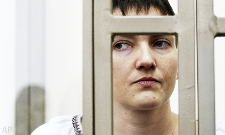 Nadiya Savchenko stands in a glass cage during a trial in the town of Donetsk, Rostov-on-Don region, Russia, Thursday, March 3, 2016. (AP Photo)