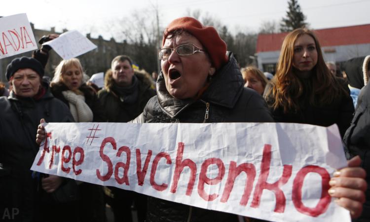 People shout slogans in support of Ukrainian pilot Nadiya Savchenko during a rally outside the Russian Embassy in Kiev, Ukraine, Sunday, March 6, 2016. (AP/Sergei Chuzavkov)