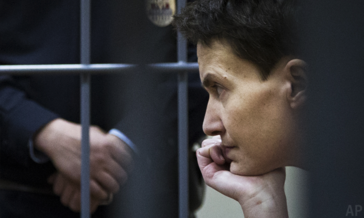 Ukrainian jailed military officer Nadiya Savchenko sits in a cage at a court room in Moscow, Russia, Wednesday, March 4, 2015. (AP Photo/Ivan Sekretarev)