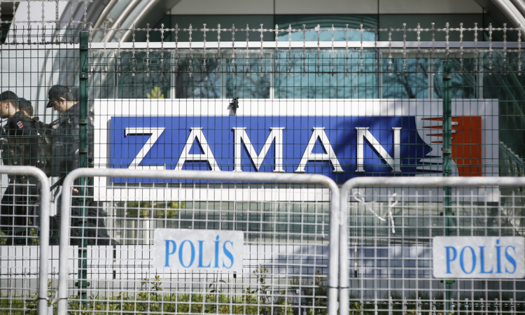 Riot police walk by the headquarters of Zaman newspaper in Istanbul, Sunday, March 6, 2016. (AP Photo/Emrah Gurel)