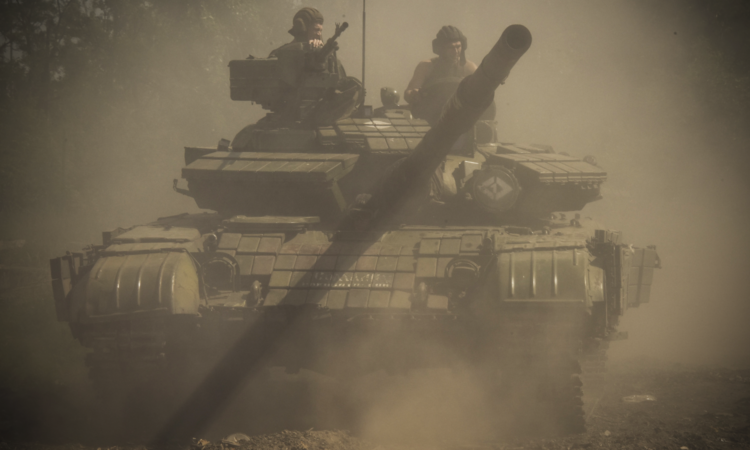 A Russia-backed separatist tank moving into position near Donetsk airport, June 12, 2015. (AP Photo/Mstyslav Chernov)