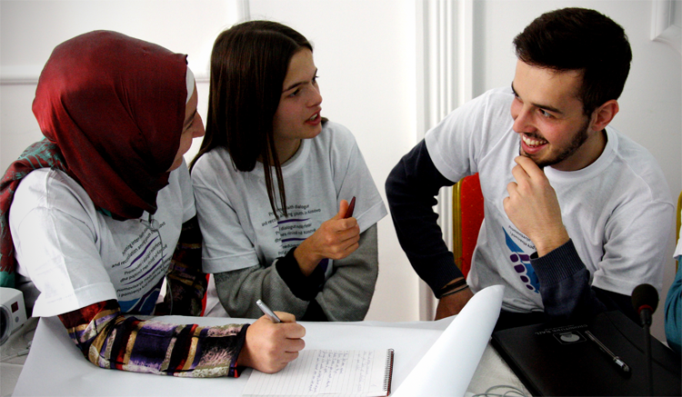 Participants at an OSCE-organized inter-faith youth camp discussing gender equality and gender roles, 14 October 2015. (OSCE)