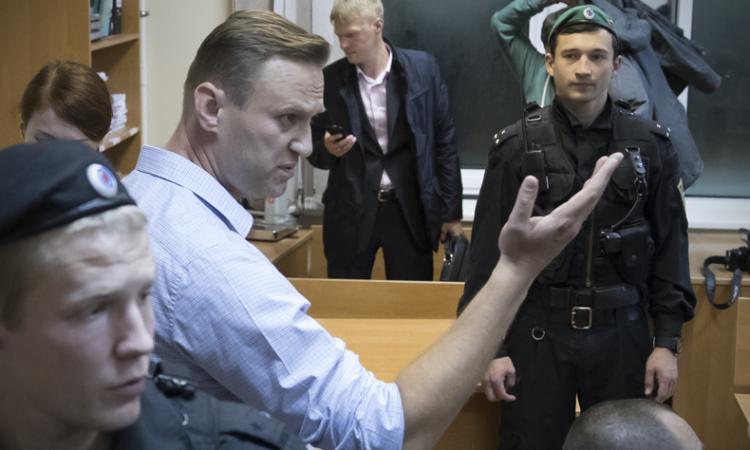 Russian opposition leader Alexei Navalny gestures while speaking in a court room in Moscow, Russia, Monday, Oct. 2, 2017. (AP photo)