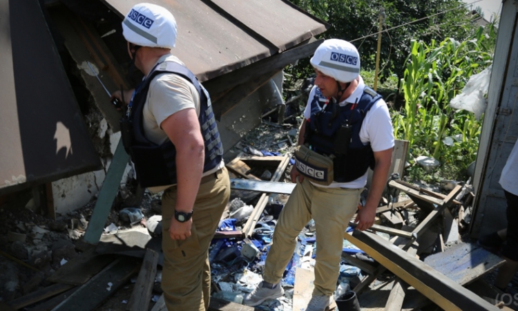 OSCE SMM monitors conducting impact site assessment in Kashtanove, Ukraine, July, 2017. (OSCE)