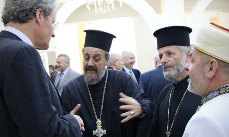Head of the OSCE Presence in Albania, Ambassador Bernd Borchardt (left), talks with representatives of religious communities on the margins of a conference on countering violent extremism, Elbasan, Albania, October 12, 2016. (OSCE photo)