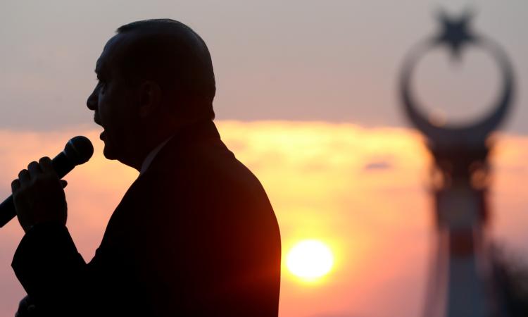 Turkey's President Recep Tayyip Erdogan delivers a speech outside the Presidential Palace, July 16, 2017 in Ankara, Turkey. (Presidency Press Service via AP, Pool)