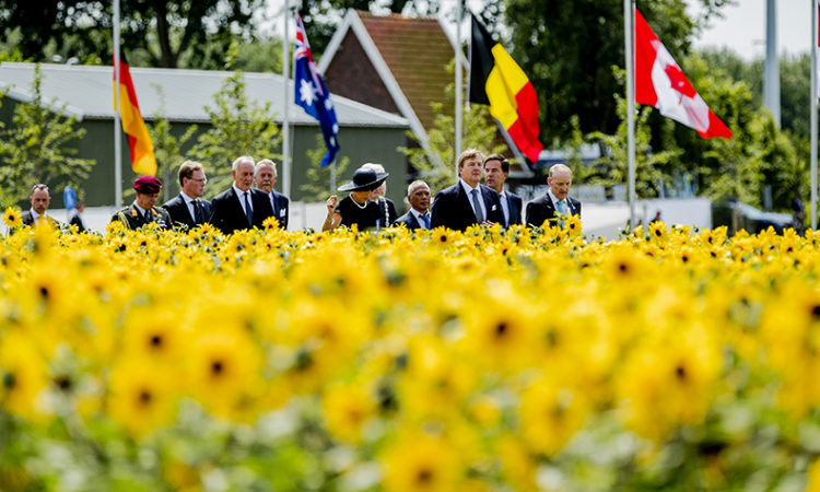 Dutch King Willem-Alexander, third right, and Queen Maxima, center, during the revealing of the National Monument for the MH17 victims in Vijfhuizen, The Netherlands, Monday, July 17, 2017. (Remko de Waal/ Pool via AP)