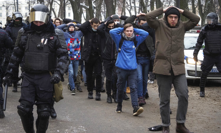 Detained protesters walk escorted by police during a protest against the jailing of opposition leader Alexei Navalny in St. Petersburg, Russia. (AP Photo/Dmitri Lovetsky, File)