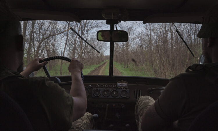Ukrainian soldiers drive towards a fighting position on the line of separation from pro-Russian rebels near Toretsk, eastern Ukraine, Thursday, May 6, 2021. (AP Photo/Felipe Dana)