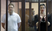 Belarus' opposition activists Maria Kolesnikova, right, and Maxim Znak attend a court hearing in Minsk, (Ramil Nasibulin/BelTA pool photo via AP)