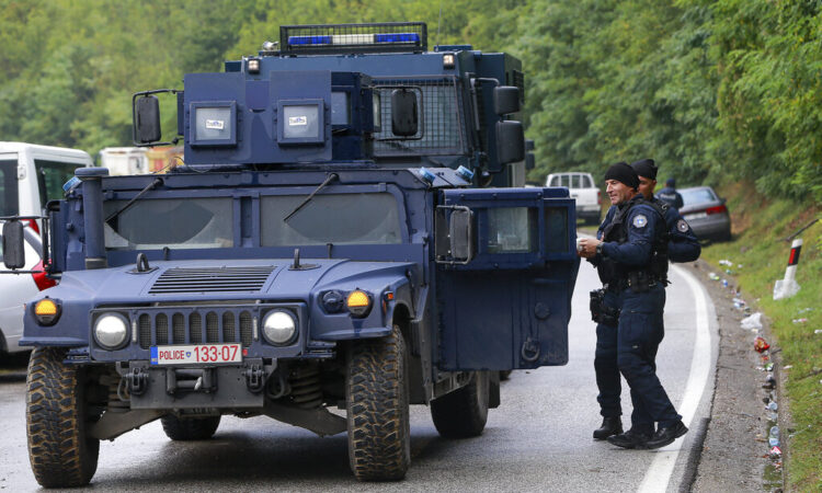 Kosovo police secure the area as Ethnic Serbs gathered on barricades near the northern Kosovo border crossing of Jarinje on the ninth day of protest on Tuesday, Sept. 28, 2021. (AP Photo/Visar Kryeziu)
