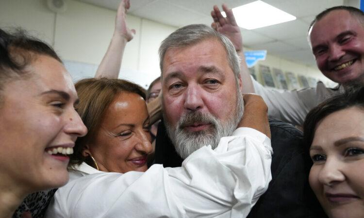 Colleagues congratulate Peace Prize laureate Novaya Gazeta editor Dmitry Muratov at the Novaya Gazeta newspaper, in Moscow, Russia, Friday, Oct. 8, 2021. (AP Photo/Alexander Zemlianichenko)