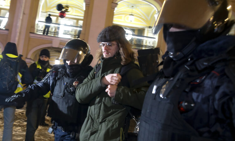 Policemen detain a Navalny supporter during a protest in St. Petersburg. (AP Photo/Dmitri Lovetsky)