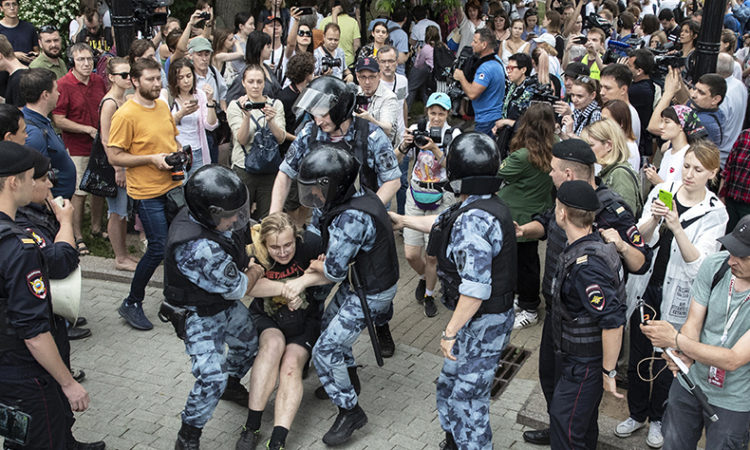 Police officers detain a protester in central Moscow on June 12, 2019 during a march against police abuse in the wake of the high-profile detention of the Russian journalist Ivan Golunov. (AP Photo/Pavel Golovkin)