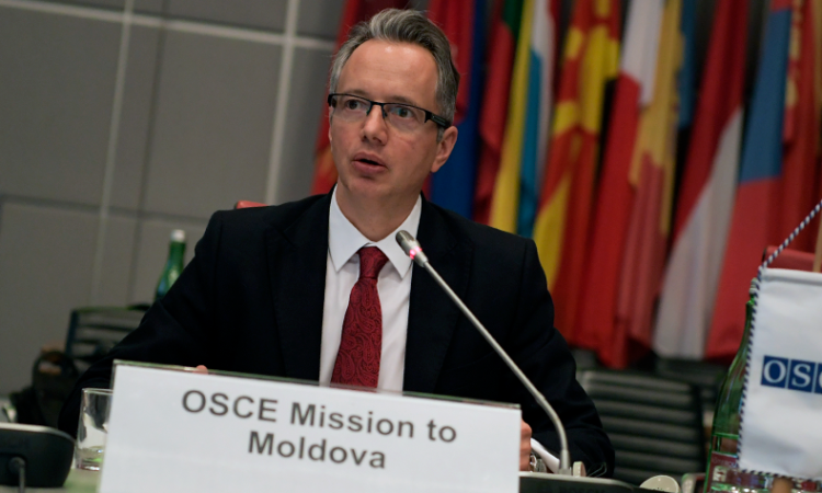 The Head of the OSCE Mission to Moldova, Ambassador Claus Neukirch,, delivers his mission's report. (USOSCE/Gower)