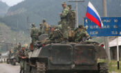 A column of Russian armored vehicles moves through North Ossetia towards the Georgia's breakaway republic of South Ossetia's capital Tskhinvali on August 8, 2008. (photo: AP/Musa Sadulayev)