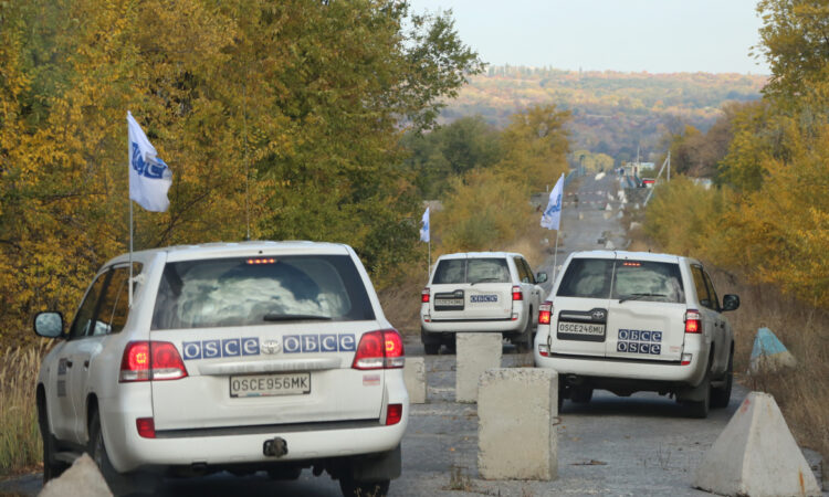 SMM patrol driving through anti-tank obstacles along the contact line (OSCE)
