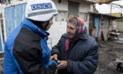 An OSCE SMM monitoring officer engages with a local resident of Travneve, Donetsk region, March 2018. Photo: OSCE/ Evgeniy Maloletka