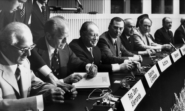 On August 1, 1975, 35 head of states signed the Helsinki Final Act Image in Finlandia House, in Helsinki, Finland. From left to right: Erich Honecker, East Germany's First Secretary, U.S. President Ford, Austrian Chancellor Bruno Kreisky, Leo Tindemans from Belgium, Todor Zhivkov of Bulgaria, Pierre Trudeau, Canada. (photo: AP/Dennis Brack)