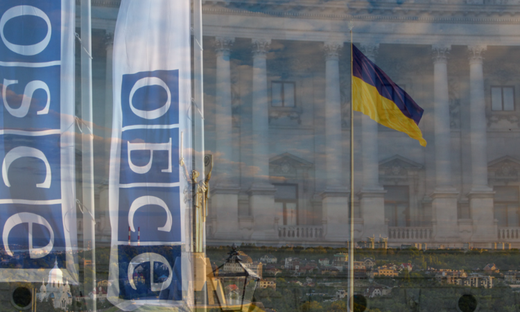 Ukrainian flags and flags with the OSCE logo