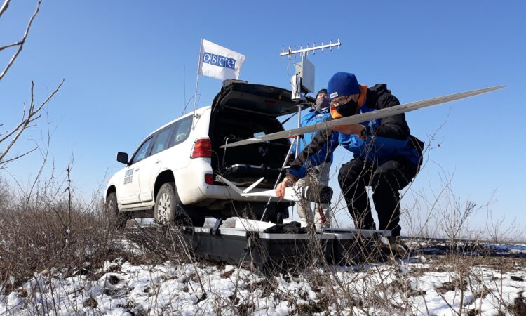SMM monitoring officers preparing to launch a UAV near Hnutove, Donetsk region (OSCE/Germain Groll)