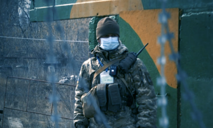 A Ukrainian soldier in a face mask.