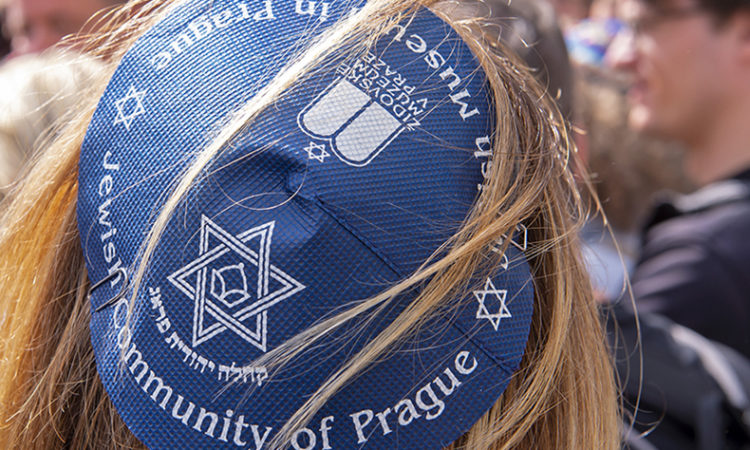People of different faiths wear the Jewish kippah during a demonstration against anti-Semitism, Erfurt, Germany, Wednesday, April 25, 2018. (AP Photo/Jens Meyer)