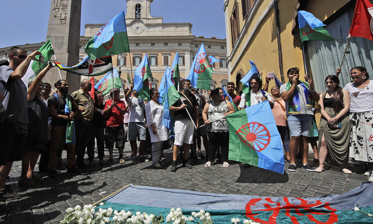 Activists outside the parliament in Rome on Roma Holocaust Memorial Day, Thursday, Aug. 2, 2018. (AP Photo)
