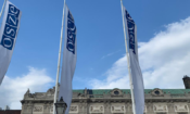 Flags with the OSCE logo in front of the Hofburg in Vienna