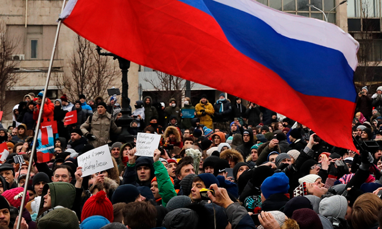 Protesters gather during a rally at Pushkin square in Moscow.