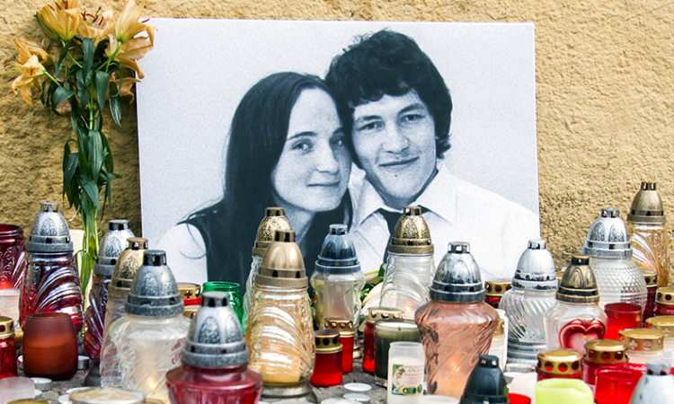 Candles are left in tribute to murdered Slovakian investigative reporter Jan Kuciak, 27, and his fiancee Martina, 27, at Slovak National Uprising Square in Bratislava, on Tuesday, Feb. 27, 2018 (Jakub Kotian/TASR via AP)