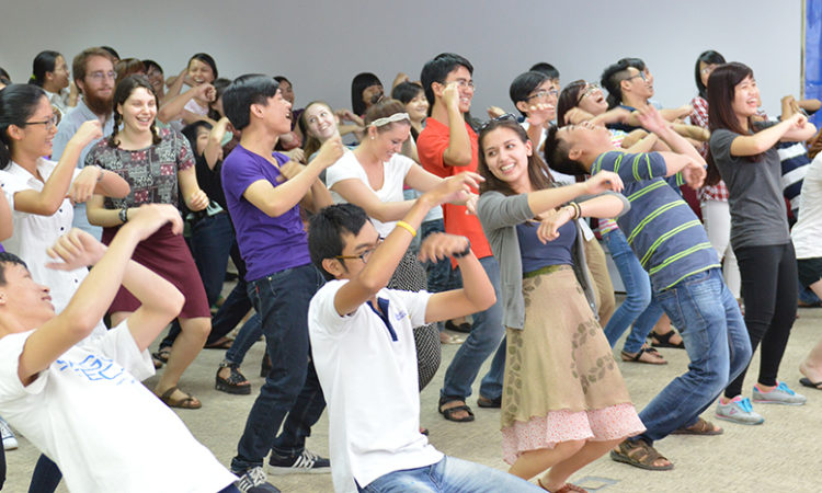 American and Vietnamese students join in a dancing activity.