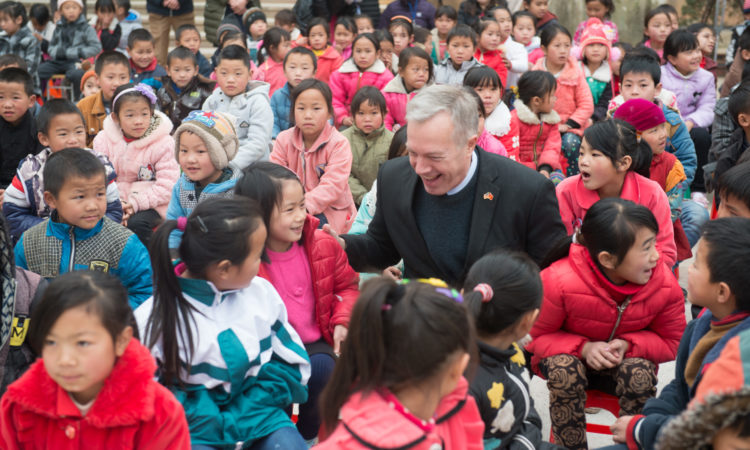 Ambassador Osius talks with students from Pho Bang Primary School