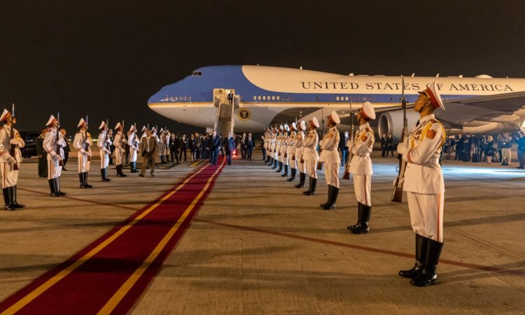 President Trump, escorted by Mai Tiến Dũng, Minister, Chairman of the Office of the Government, walks along a red carpet from Air Force One and reviews an Honor Cordon upon his arrival Tuesday, Feb. 26, 2019, at Noi Bai International Airport in Hanoi. (White House Photo by Shealah Craighead)