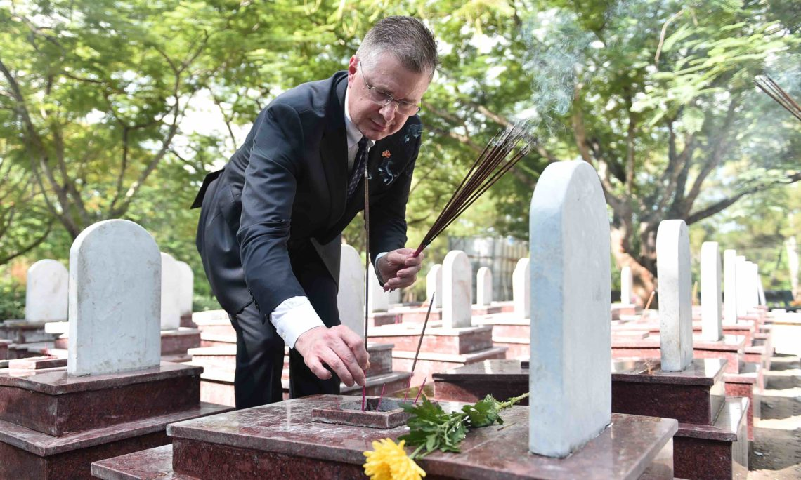 Ambassador Kritenbrink and Quang Tri officials pay a visit and offer incense at the Truong Son National Cemetery.