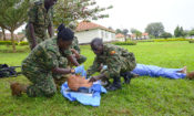 Students from the Uganda Peoples' Defense Forces use a training mannequin to practice establishing a patient's airway as part of a Tactical Combat Casualty Care Course held at the Allied Health Nursing School in Jinja, Uganda.