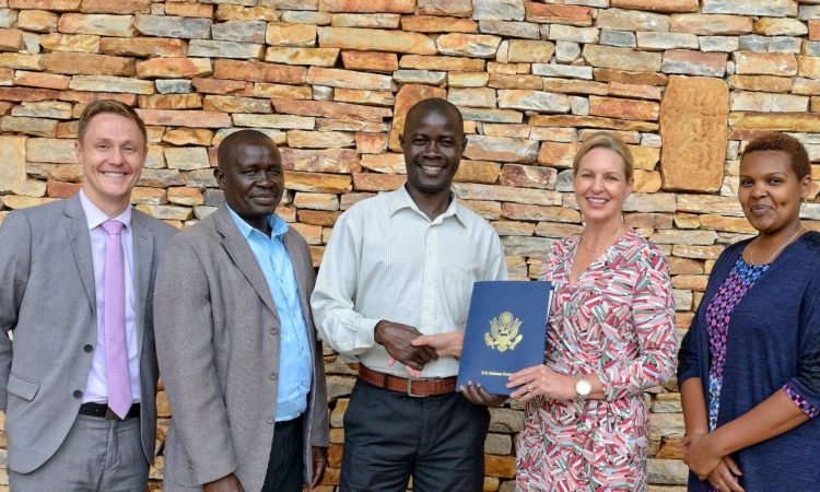 U.S. Embassy's Deputy Refugee Coordinator DeMark Schulze, World Action Fund's Board Chairman Draga Joy Caramello and Executive Director Peter Odama, U.S. Embassy's Regional Refugee Coordinator Jean Woynicki and Program Assistant Annie Gacukuzi take part in the September 20th award signing ceremony at the U.S. Embassy in Kampala.
