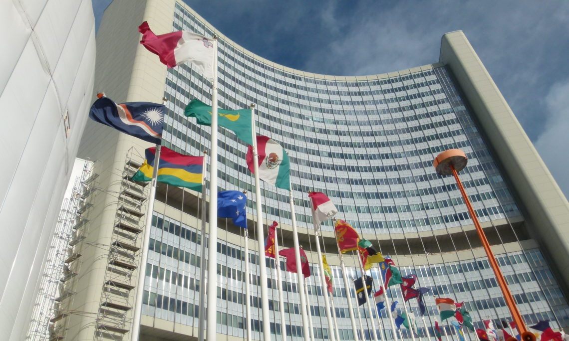 View of a modern office building with international flags in front
