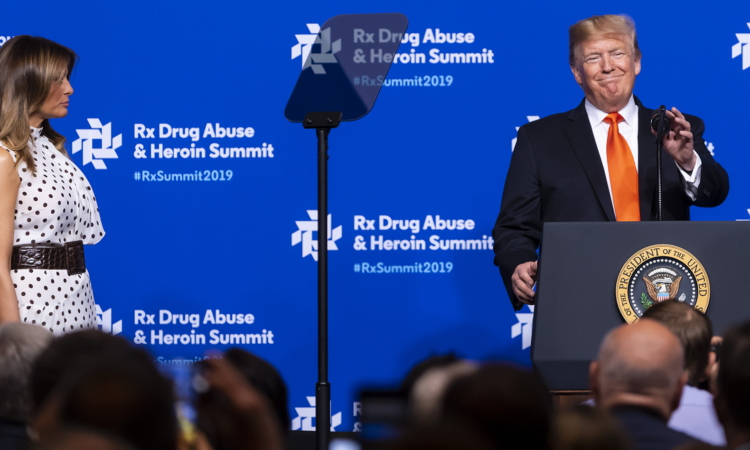 President Donald Trump takes the podium as first lady Melania Trump looks on during the RX Drug Abuse & Heroin Summit, Wednesday, April 24, 2019 in Atlanta. (AP Photo/John Amis)