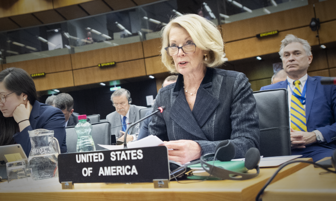 Ambassador Jackie Wolcott speaks from behind the U.S. nameplate at the March 2020 IAEA Board of Governors meeting.