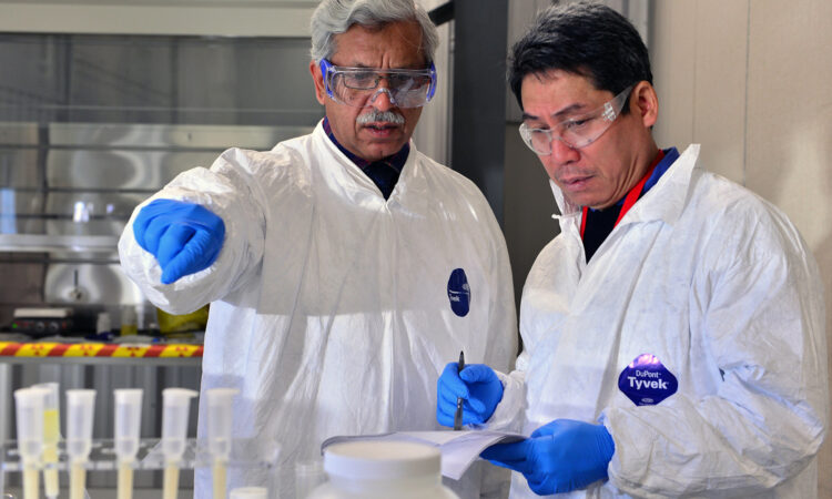 In this photo from the IAEA archives, nuclear forensic scientists share their expertise. Nuclear forensics contributes to nuclear security worldwide. (IAEA/Dean Calma)