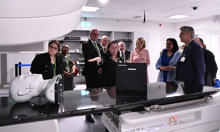 May Abdel-Wahab, IAEA Director, Division of Human Health, Department of Nuclear Science and Applications, presents a tour of the Linac Facility at the ReNuAL Event in Seibersdorf, June 2019. (IAEA/Dean Calma)