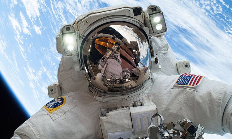 NASA astronaut Mike Hopkins participates in a December 2013 spacewalk. (NASA)