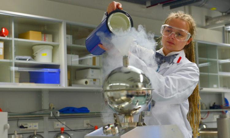 Female employee working in in a complex laboratory set-up. Photo: IAEA/Dean Calma.