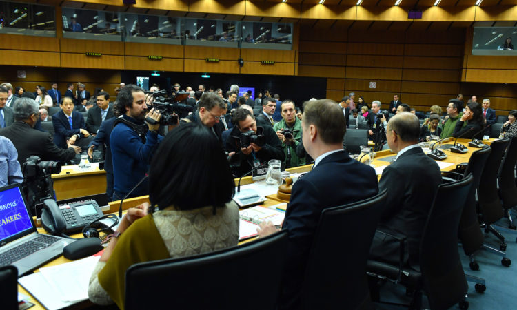 Journalists with cameras taking pictures of the IAEA Board Room