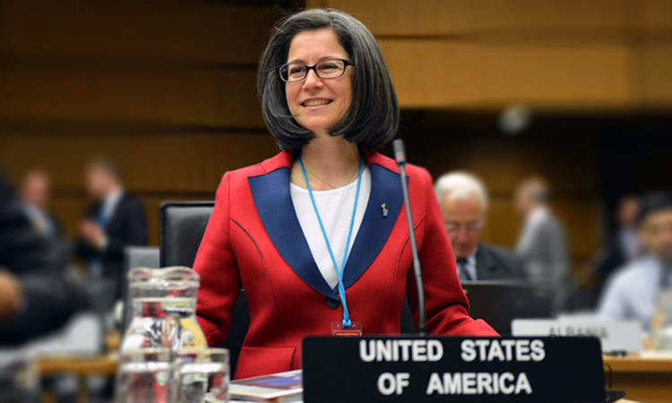Female official representing the U.S. at an international conference on nuclear issues.